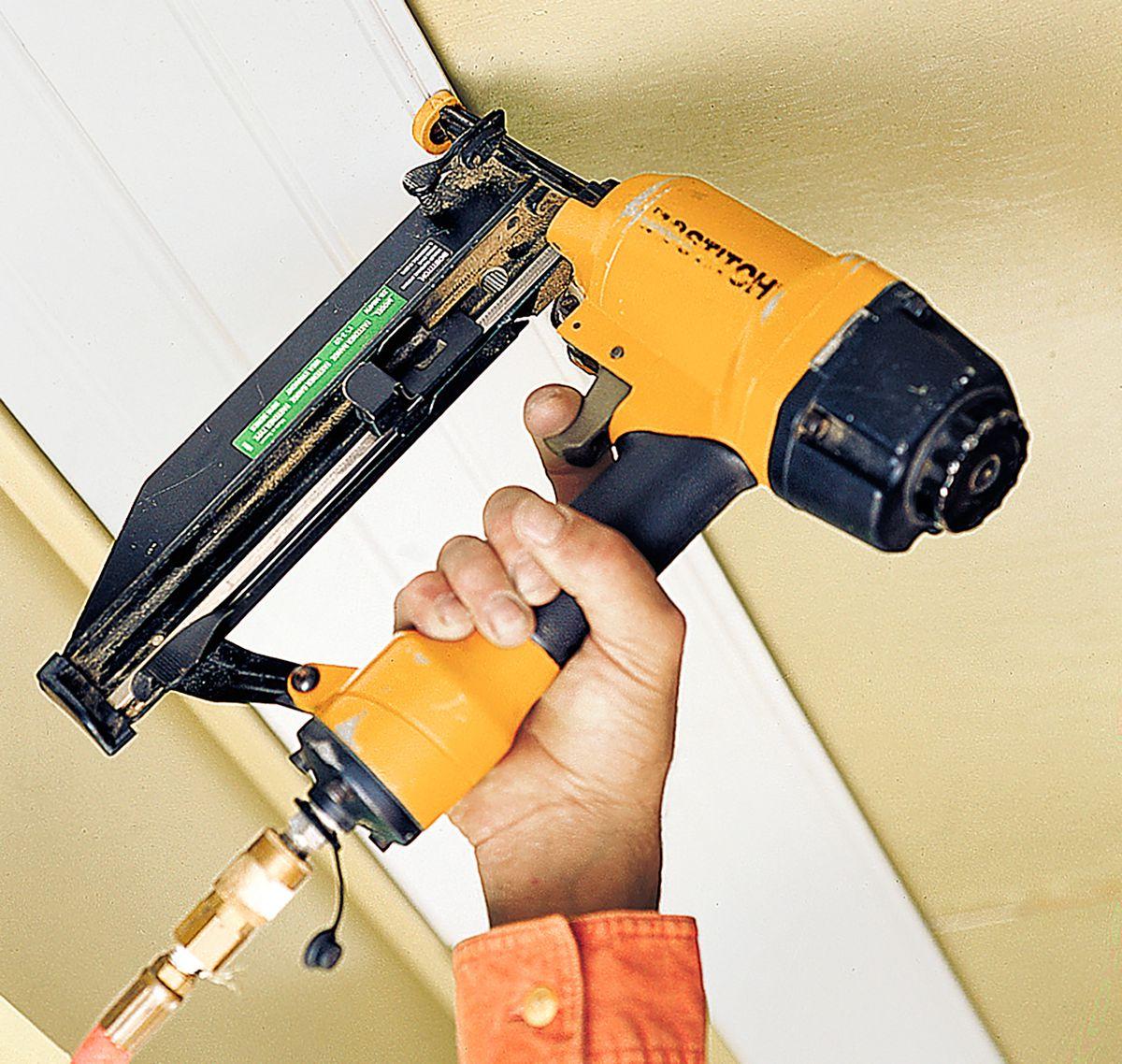 Man Installs Wood Panel