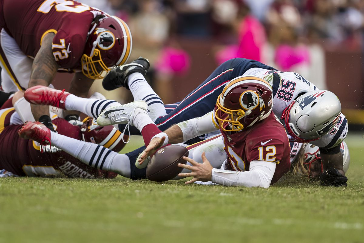 Jamie Collins of the New England Patriots causes Washington quarterback Colt McCoy of the Washington to fumble the ball during the second half at FedExField on October 6, 2019 in Landover, Maryland.