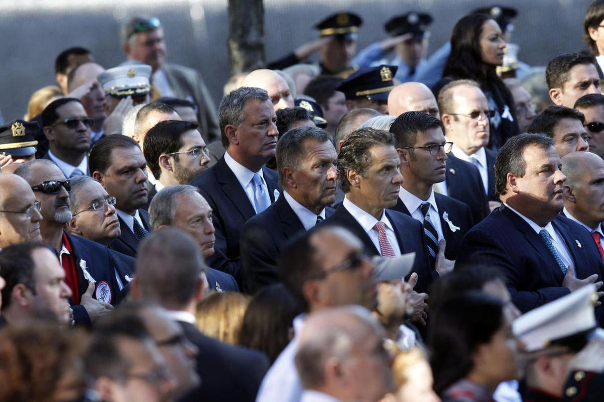Former New York Mayor Rudolph Giuliani, far left, New York Mayor Michael Bloomberg, fifth left, New York Governor Andrew Cuomo, fourth right, and New Jersey Governor Chris Christie, second right, attend as friends and relatives of the victims of the Sept.