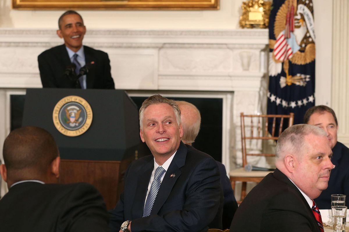 Virginia Gov. Terry McAuliffe in front of President Barack Obama.