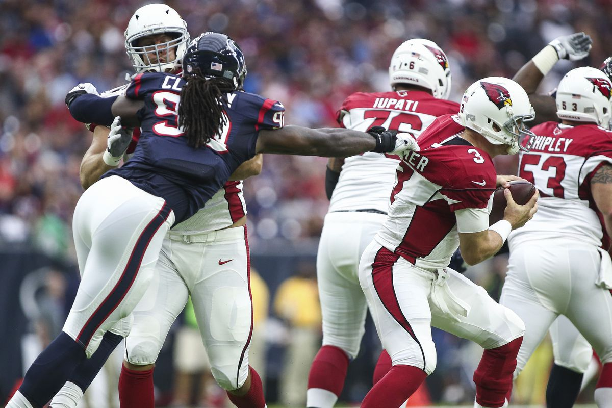 Believe it or not, Carson Palmer somehow got out of this sack. The old man is slippery...