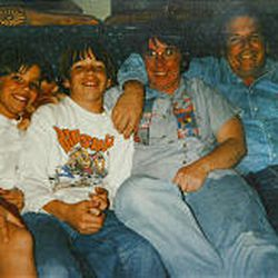 The Berg family relaxes on a sofa at their Mountain Green home before the tragic shooting: from left, Whitney, PJ, Loydene and Peter. Today the Berg home is full of warmth and photos and memories of Peter. The family has struggled to cope with being without him.