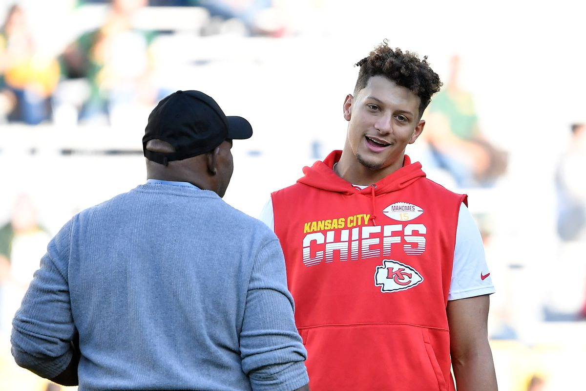 Kansas City Chiefs quarterback Patrick Mahomes talking with an assistant coach before a preseason game against the Green Bay Packers at Lambeau Field on August 29, 2019 in Green Bay, Wisconsin.