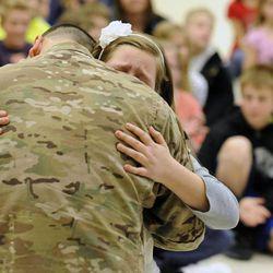 Addie Goettig hugs her dad, Air Force Tech Sgt. Edward Goettig, at Fox Hollow Elementary School on Thursday, March 6, 2014. Goettig had been deployed to Afghanistan since Aug. 27, 2013.