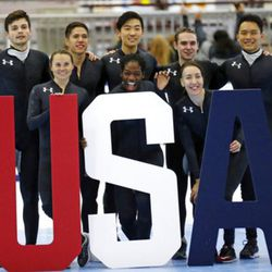 Nominees to the Olympic team, from left to right rear, John-Henry Krueger, J.R. Celski, Thomas Insuk Hong, Ryan Pivirotto, Aaron Tran and from left to right, front, Jessica Kooreman, , Maame Biney, Lana Gehring, pose for a photo after the U.S.Olympic short track speedskating trials Sunday, Dec. 17, 2017, in Kearns, Utah. (AP Photo/Rick Bowmer)