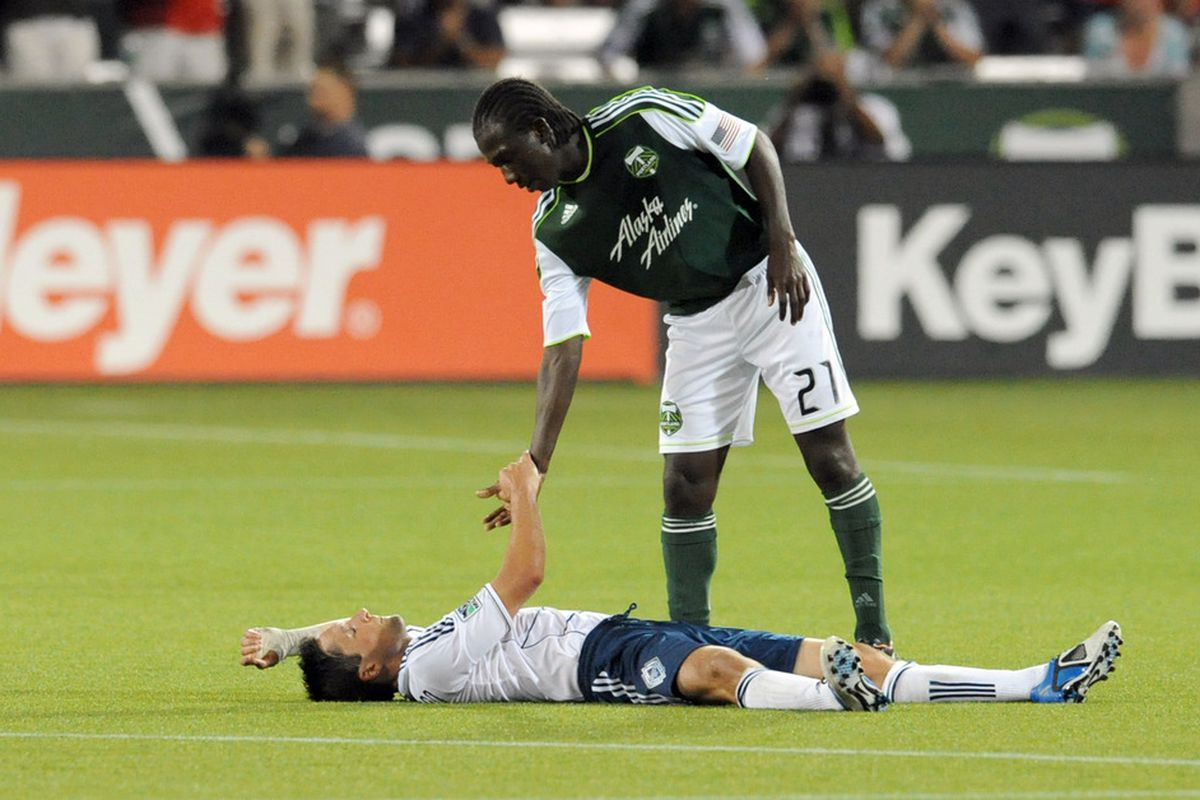 Diego Chara and the Timbers hope to flatten John Thorrington and the Whitecaps again today. (Photo by Steve Dykes/Getty Images)