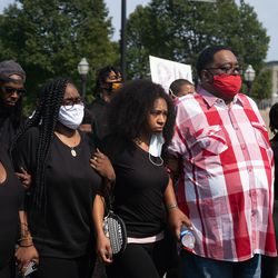 Jacob Blake's family walks to a press conference Tuesday afternoon, Aug. 25, 2020. Police shot Blake at least seven times in the back Sunday as he was breaking up a fight in Kenosha, according to his attorneys.