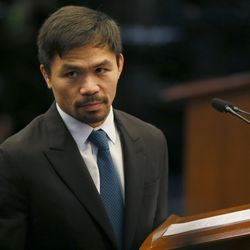 """Filipino boxer and now Senator Manny Pacquiao listens to an interpellation by a fellow senator shortly after delivering his """"privileged speech"""" at the session of the Philippine Senate Monday, Aug. 8, 2016, in suburban Pasay city south of Manila, Philippines. Pacquiao urged Congress to pass a law to restore capital punishment in the wake of the """"War on Drugs"""" campaign by Philippine President Rodrigo Duterte."""