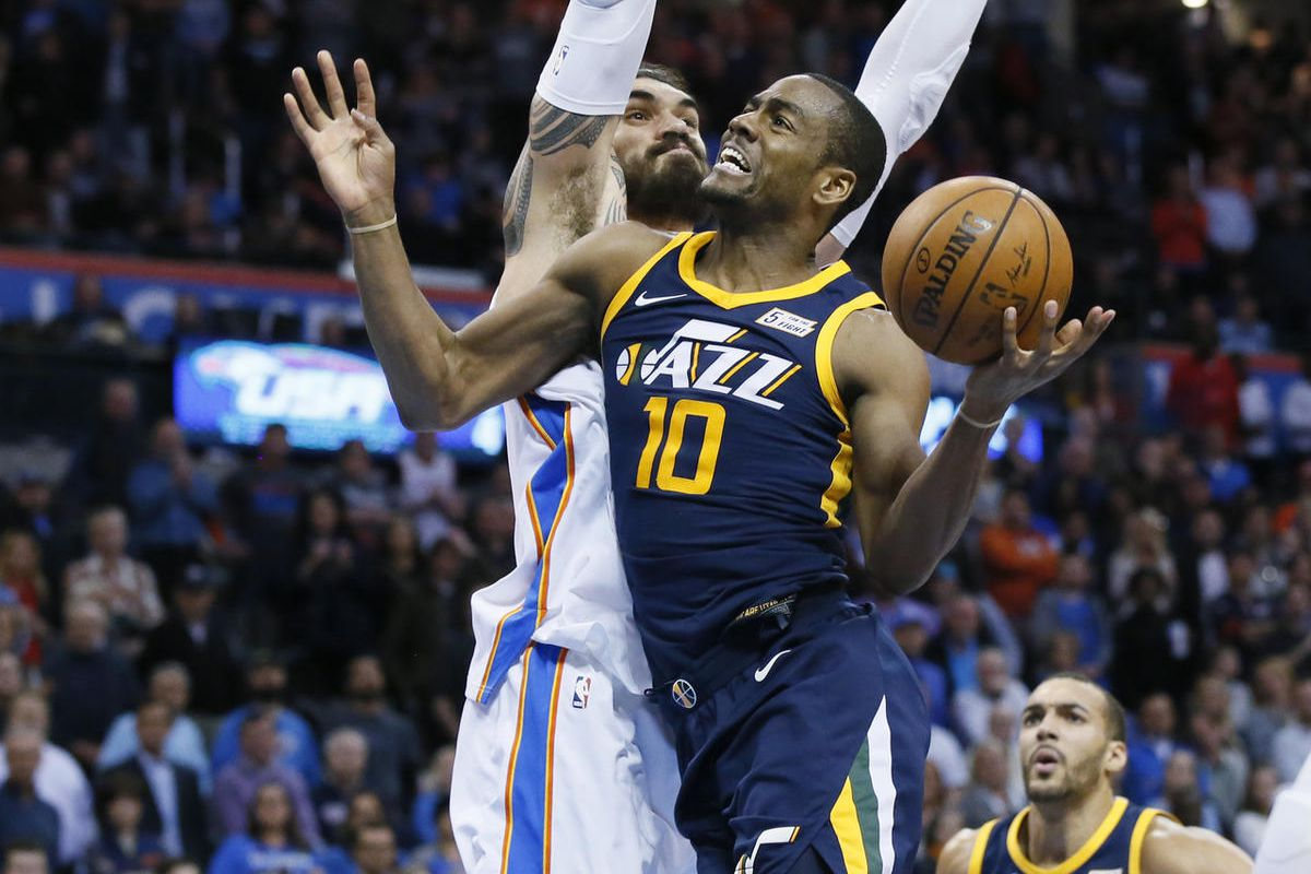 Utah Jazz guard Alec Burks (10) drives to the basket in front of Oklahoma City Thunder center Steven Adams (12) in the fourth quarter of an NBA basketball game in Oklahoma City, Tuesday, Dec. 5, 2017. Oklahoma City won 100-94. (AP Photo/Sue Ogrocki)