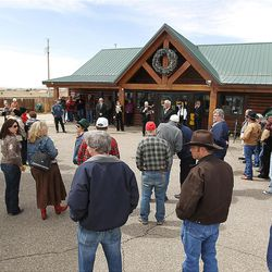 A group of nearly 50 look on as the town of Buford, Wyo., is auctioned for $900,000 to Pham Dinh Nguyen.