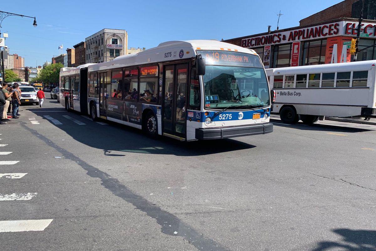 A Bx19 bus heads down E. 149th Street in the Bronx.