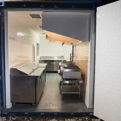A look through the shipping container doors into the new kitchen