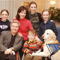 Michael Ballam joins his wife, Laurie, and four of their six children, Ester, left, Vanessa, rear, Ben and Olivia.
