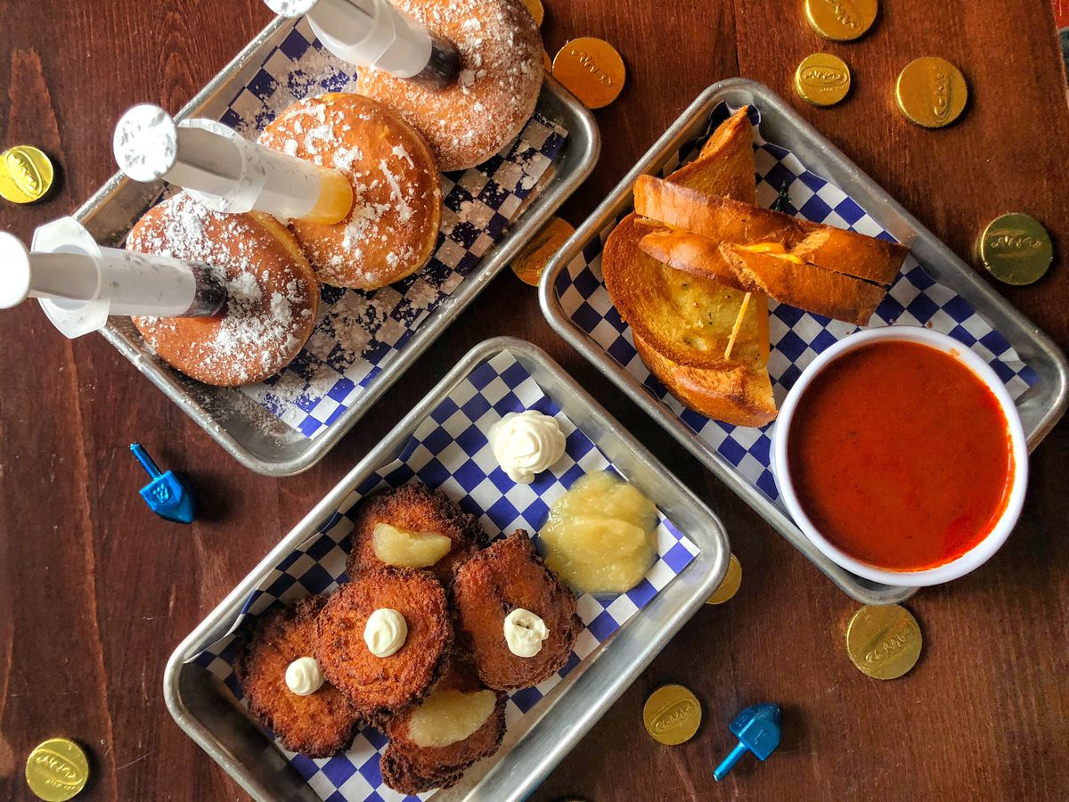 A table of boozy jelly donuts, latkes, and challah grilled cheese.