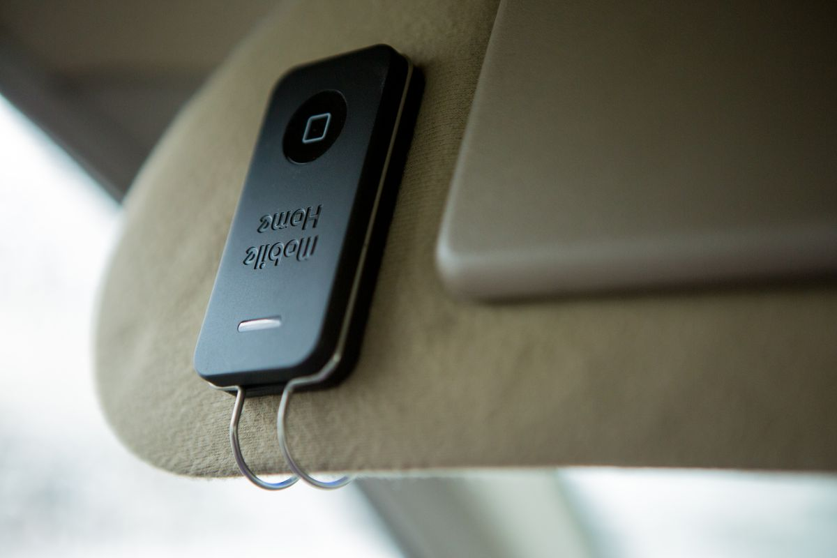 The Mobile Home iPhone Remote clips to your car's visor.