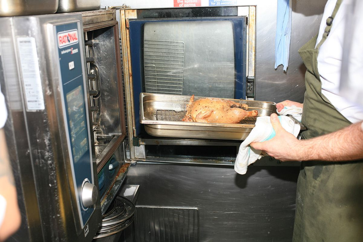 A roast chicken gets put into a commercial oven