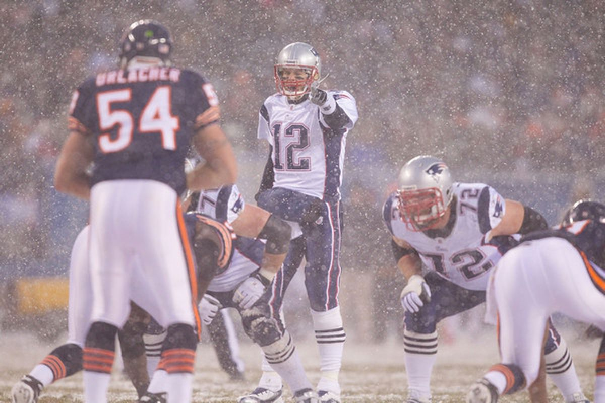 CHICAGO IL - DECEMBER 12: Tom Brady #12 of the New England Patriots directs the offense against the Chicago Bears at Soldier Field on December 12 2010 in Chicago Illinois.  The Patriots beat the Bears 36-7.  (Photo by Dilip Vishwanat/Getty Images)