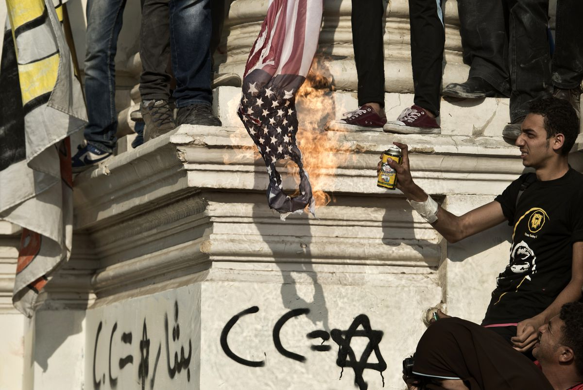A suporter of former Egyptian President Muhammed Morsi burns an American flag in October 2013. Khaled Desouki/AFP/Getty Images
