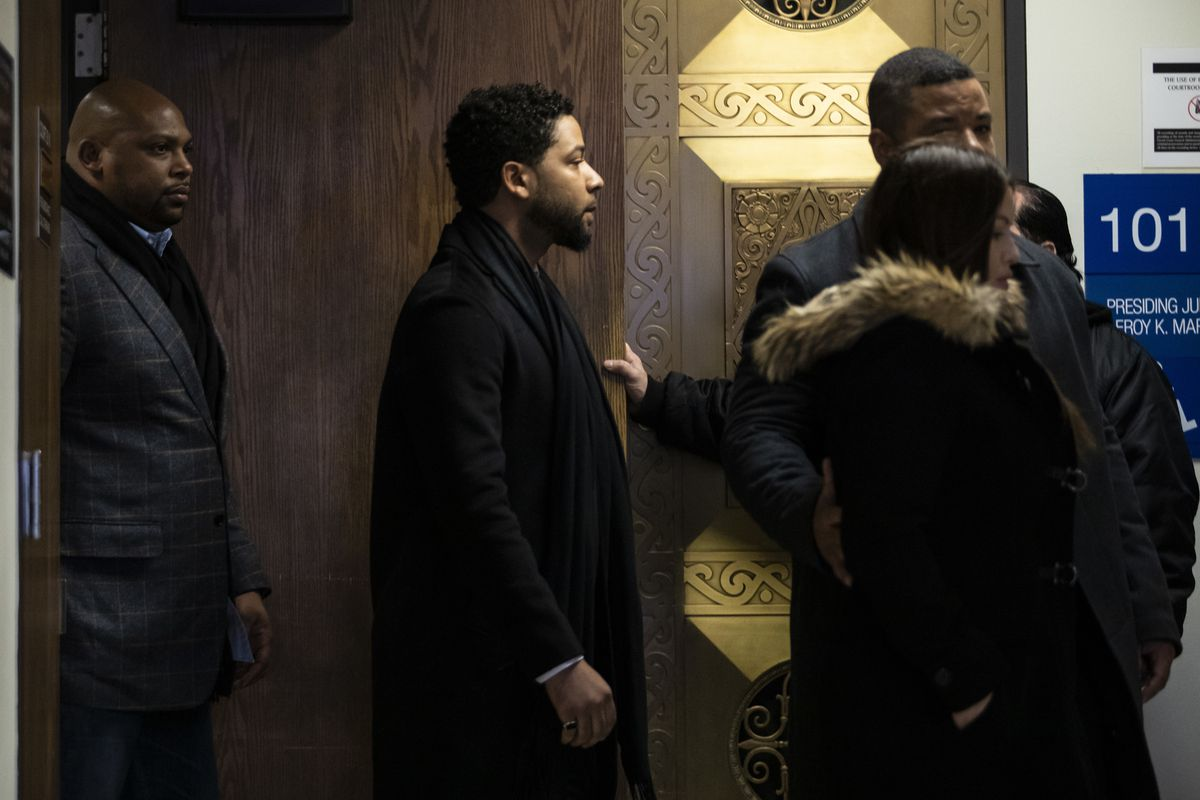 Actor Jussie Smollett walks out of one courtroom after his case was assigned to Cook County Judge James Linn at the Leighton Criminal Courthouse on February 24, 2020.