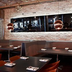"""Large leather booths will accommodate diners feasting on the """"divide"""" menu"""