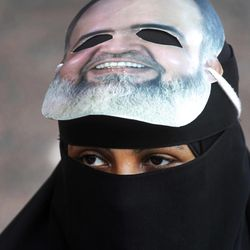 An Egyptian woman wears a mask of a potential candidate presidential candidate  Hazem Abu Ismail as she attends a supprt rally outside a courtroom in Cairo, Egypt, Wednesday, April 11, 2012. Abu Ismail is challenging authorities to produce evidence backing their allegations that his mother has a U.S. citizenship, thus disqualifying him from the presidential race.