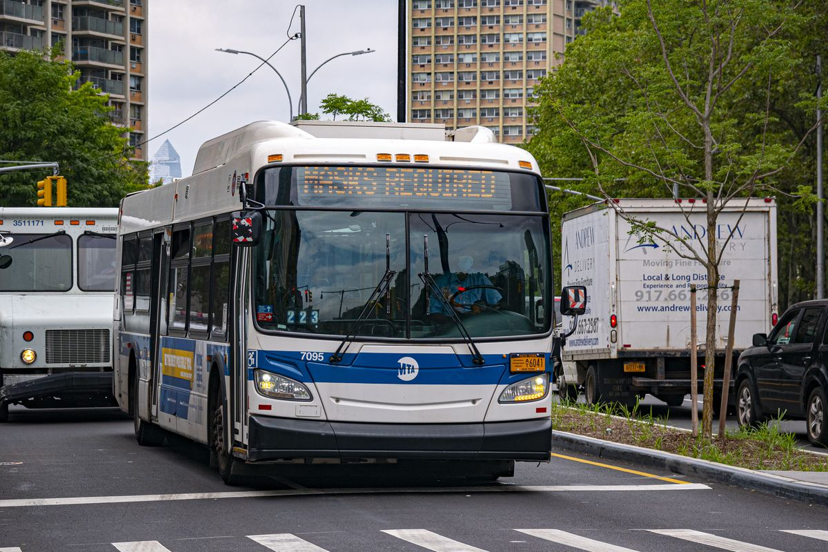 MTA Bus signage indicating masks are required for passengers, who rode free over the summer. July 7, 2020.