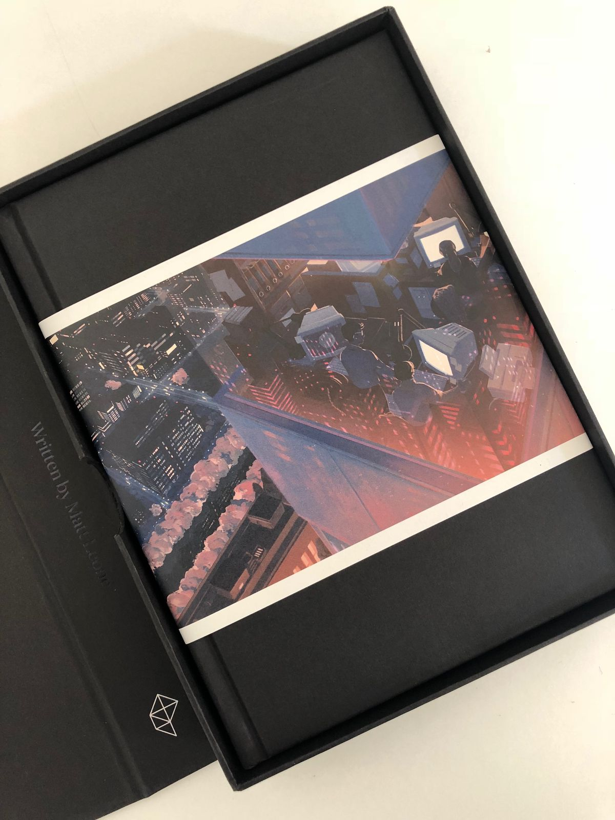 500 Years Later: An Oral History of Final Fantasy VII - photo of book sitting inside Special Box Set Edition