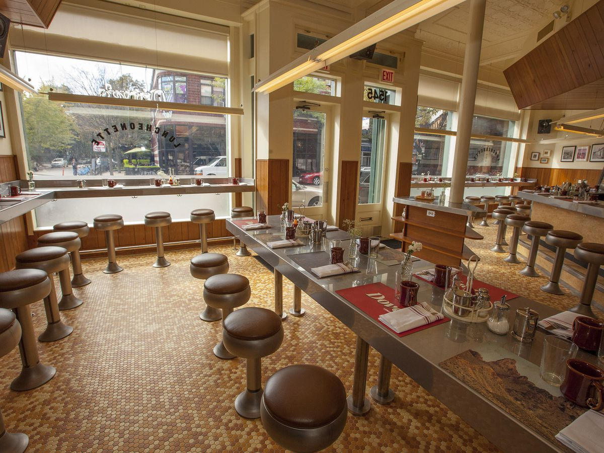 A quaint diner-style space with a long metal counter and lots of stools.