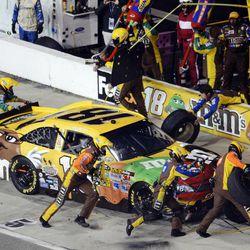 Kyle Busch (18) pits during the NASCAR Sprint Cup Series auto race at Richmond International Raceway in Richmond, Va., Saturday, April 28, 2012.