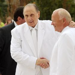 President Thomas S. Monson greets Elder Kent F. Richards of the Seventy and director of the church's temple department at the Ogden Temple on Sunday, Sept. 21, 2014.