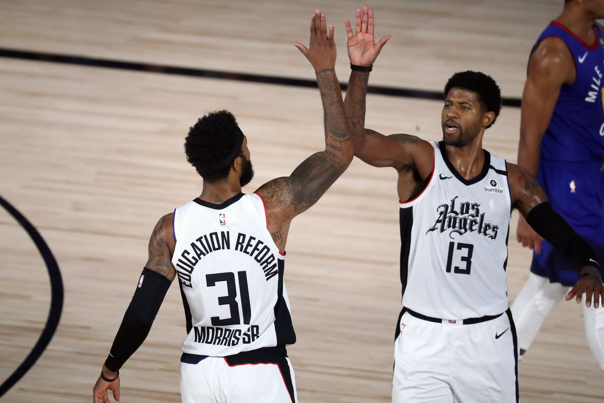 Clippers forward Marcus Morris Sr. (31) and guard Paul George (13) celebrate during the first half of game five against the Denver Nuggets in the second round of the 2020 NBA Playoffs at ESPN Wide World of Sports Complex.