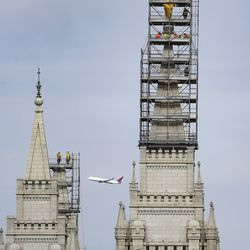 Crews prepare to temporarily remove the Angel Moroni statue from atop the Salt Lake Temple of The Church of Jesus Christ of Latter-day Saints in Salt Lake City on Monday, May 18, 2020.
