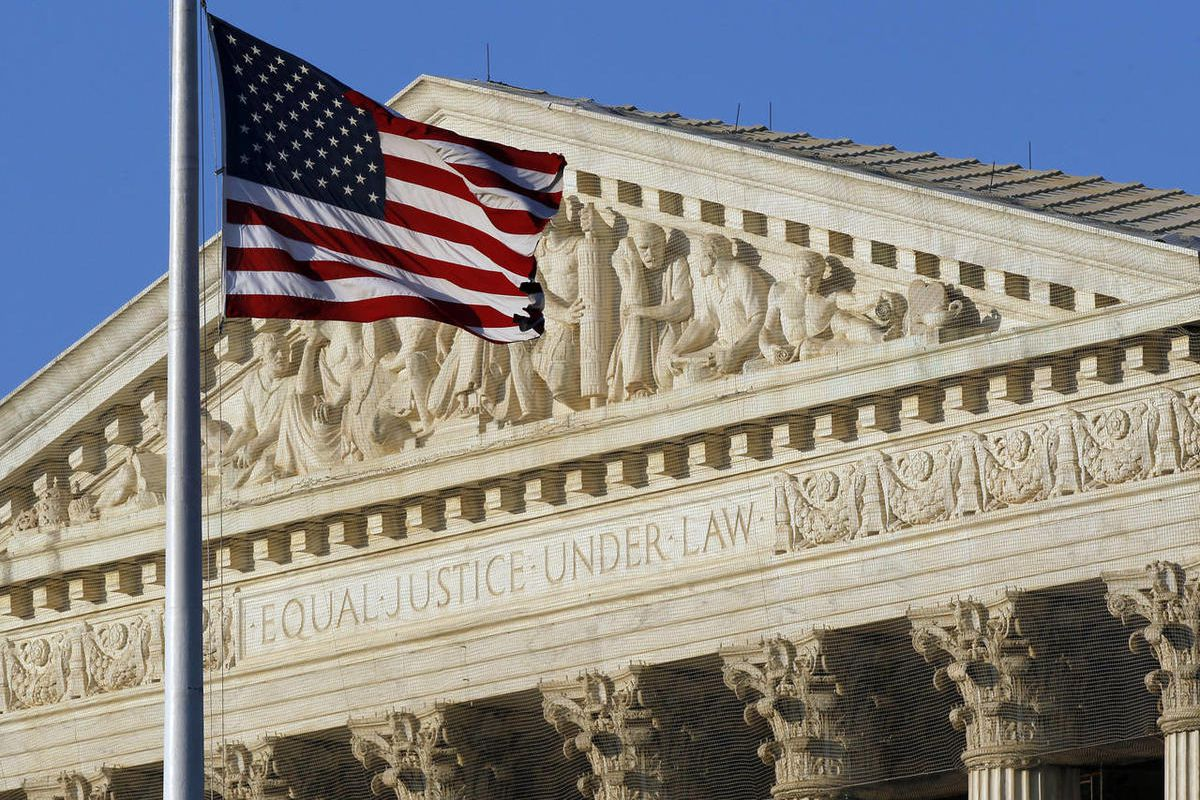 An American flag flies in front of the U.S. Supreme Court.