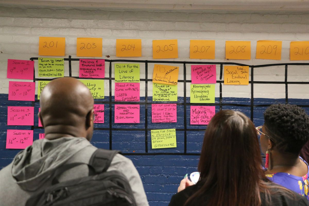 The day's sessions were handwritten on note cards taped to the wall.