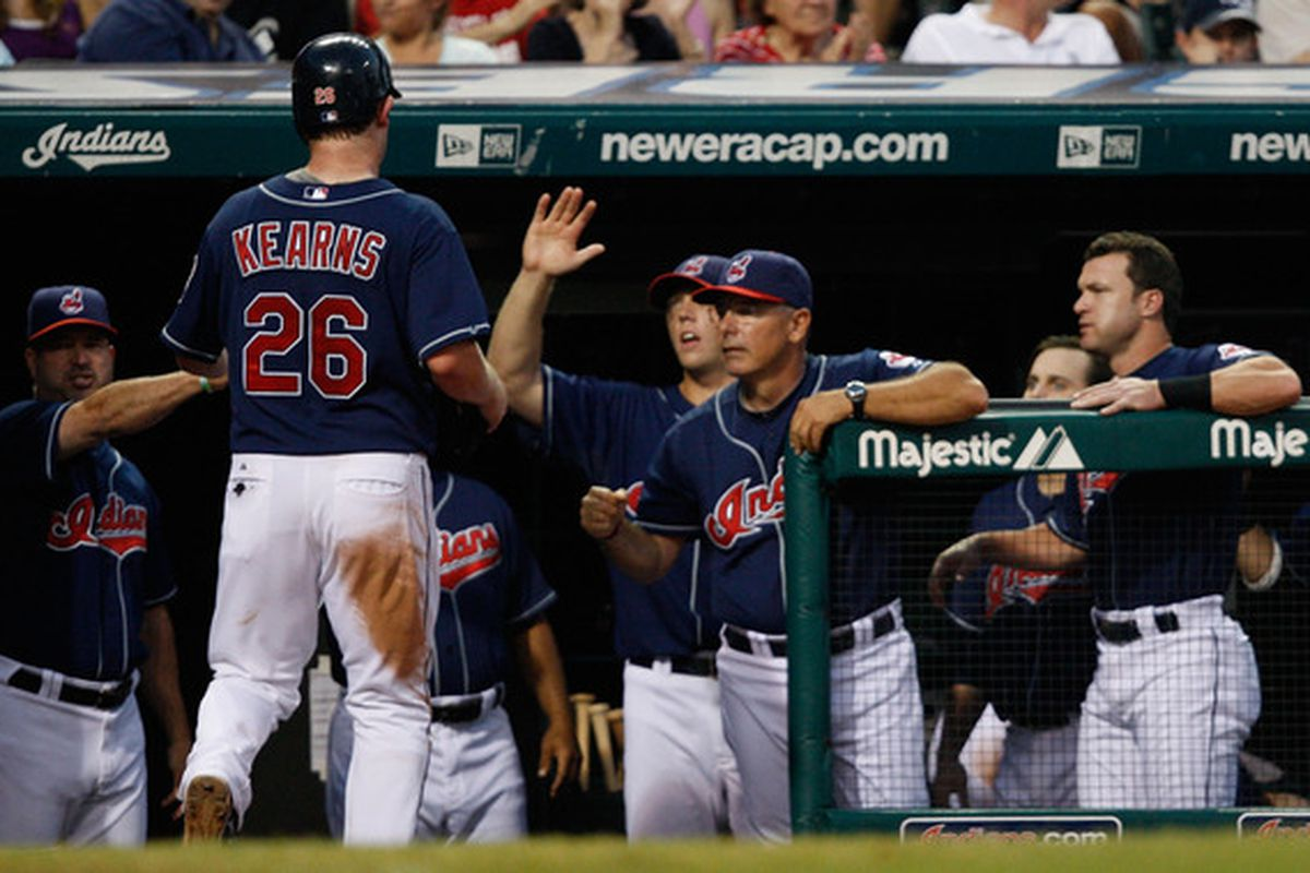 CLEVELAND - JULY 27:  Austin Kearns #26 of the Cleveland Indians is congratulated by teammates after scoring against the New York Yankees during the game on July 27 2010 at Progressive Field in Cleveland Ohio.  (Photo by Jared Wickerham/Getty Images)