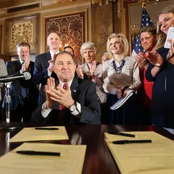 Gov. Gary Herbert and others applaud after Herbert signed SCR9, a resolution the state Legislature unanimously passed earlier this year declaring pornography a public health crisis. The signing was held in the Gold Room at the Capitol in Salt Lake City on Tuesday, April 19, 2016.