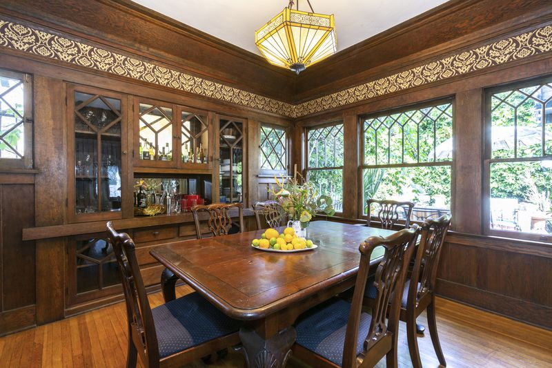 Dining room with wooden built-ins and a wooden dining table.