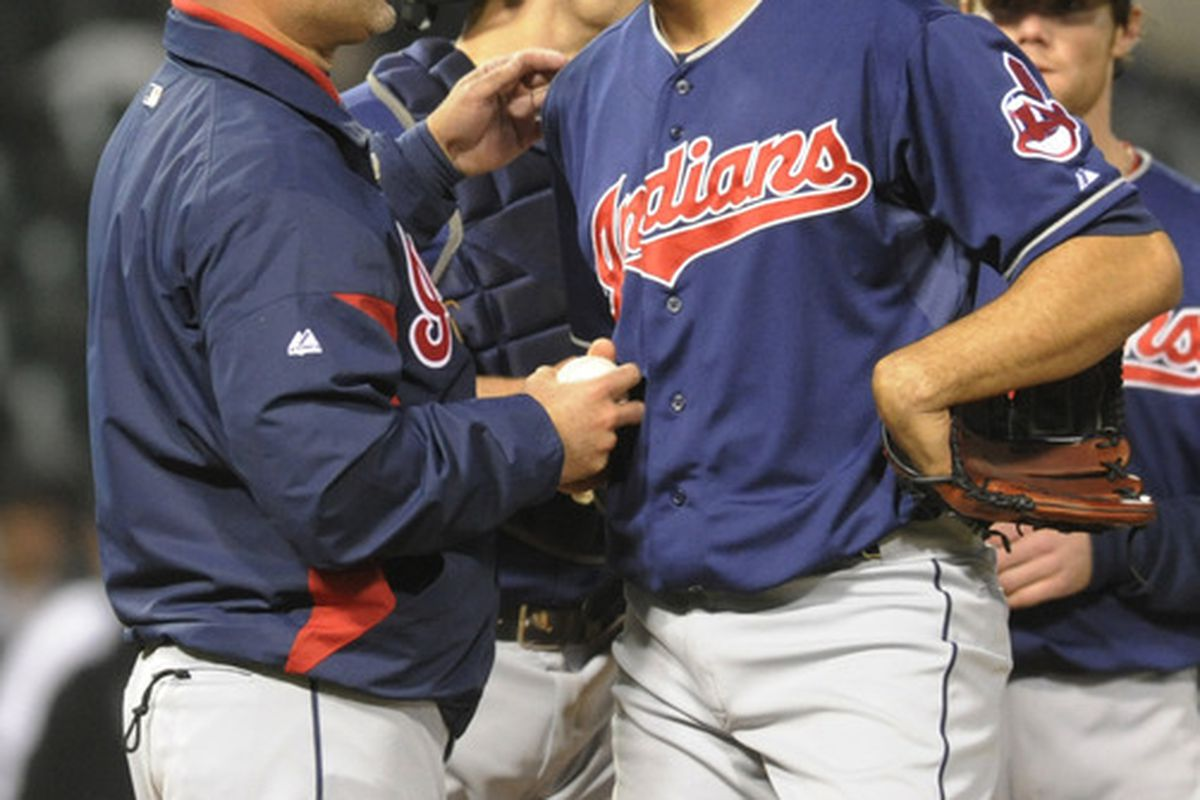 CHICAGO, IL - MAY 01: Manny Acta #11 manager of the Cleveland Indians takes Ubaldo Jimenez #30 out of the game in the fifth inning on May 1, 2012 at U.S. Cellular Field in Chicago, Illinois.  (Photo by David Banks/Getty Images)