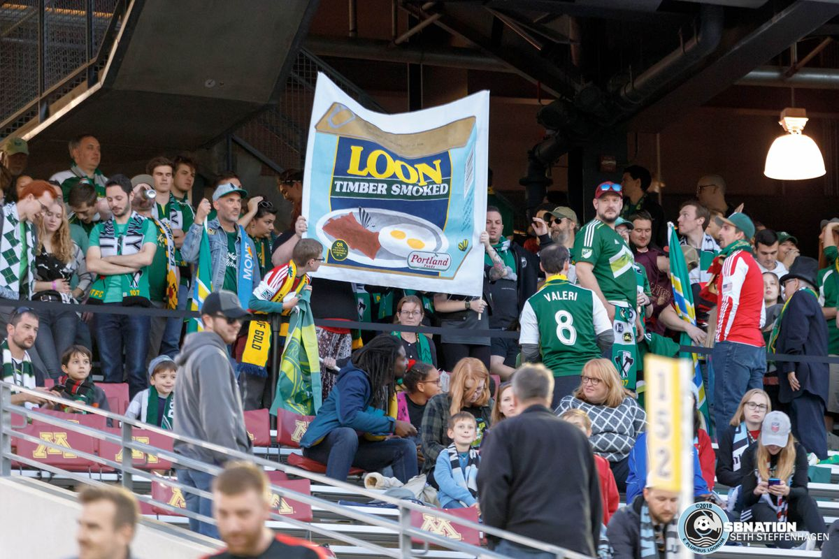 September 22, 2018 - Minneapolis, Minnesota, United States - Traveling Portland Timbers supporters hold up a two pole banner to taunt Minnesota during the match at TCF Bank Stadium.