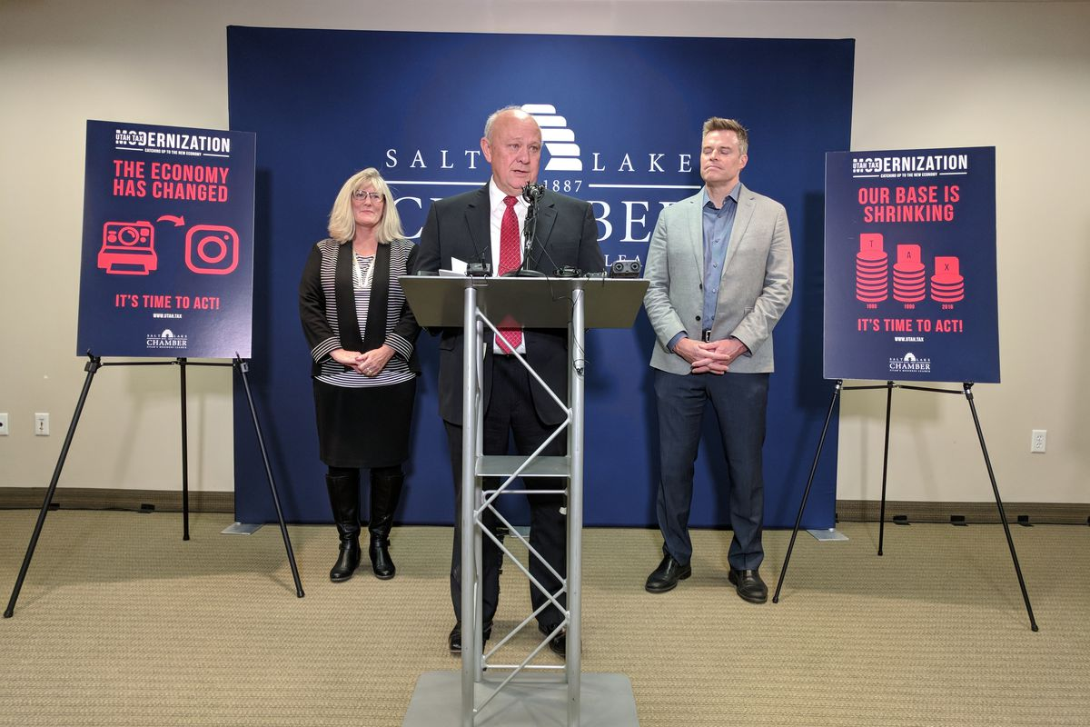 Lane Beattie, president and CEO of the Salt Lake Chamber, center, is joined by board members Cindy Crane, president and CEO of Rocky Mountain Power, left, and Vance Checketts, vice president and general manager of Dell EMC, during a press conference in Sa