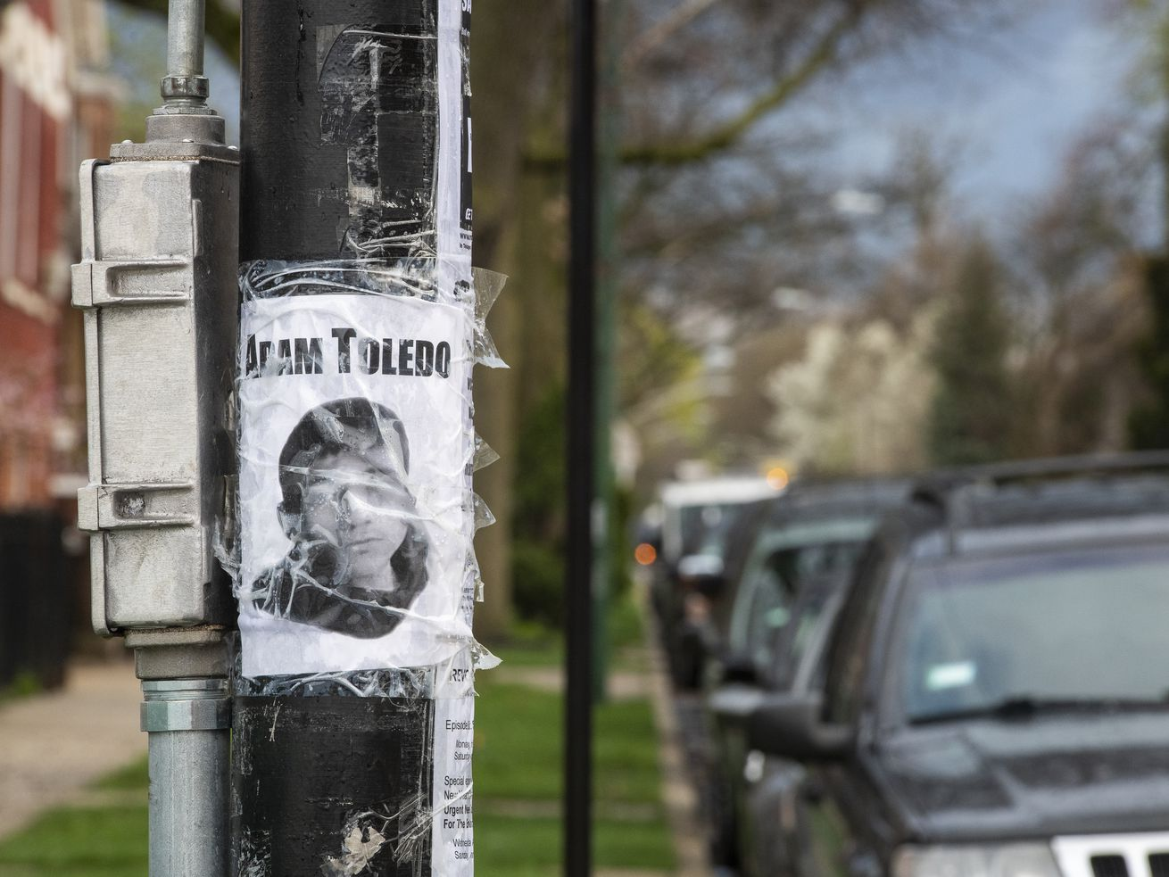A picture of Adam Toledo is taped to a pole at the corner of 24th St. and Spaulding Ave. in the Little Village neighborhood.