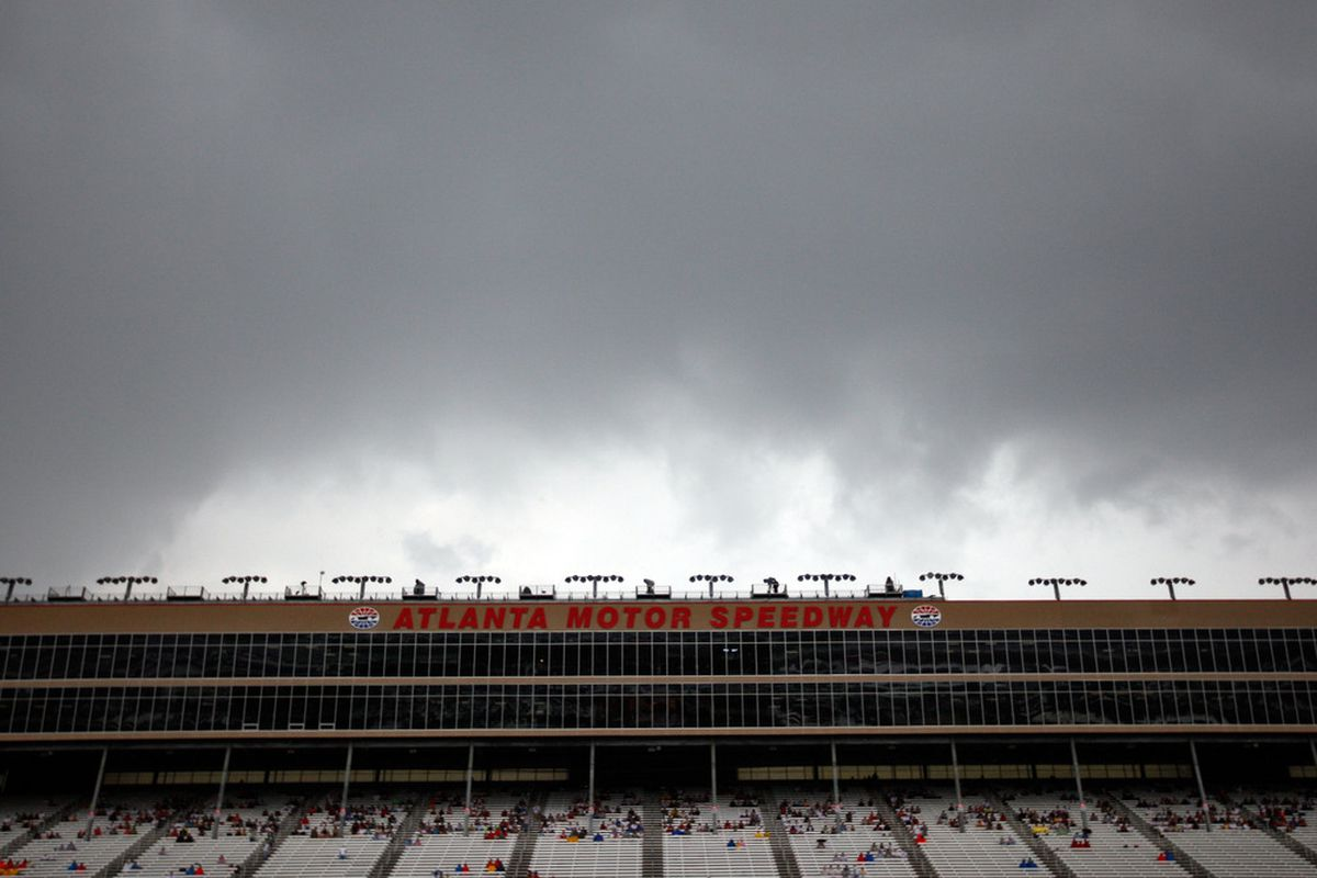 HAMPTON, GA - SEPTEMBER 04:  Rain clouds hang over the racetrack prior to the NASCAR Sprint Cup Series AdvoCare 500 at Atlanta Motor Speedway on September 4, 2011 in Hampton, Georgia.  (Photo by Chris Graythen/Getty Images)