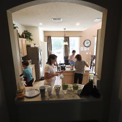 Tom and Heather Wakefield fix breakfast with their children —Taylor, Kelsie, Adam, Xande and Lincoln — at their home in Kissimmee, Fla., on Monday Dec 21, 2020.