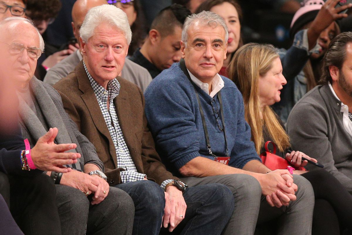 Former president Bill Clinton sits courtside with Milwaukee Bucks co-owner Marc Lasry during the first quarter against the Brooklyn Nets at Barclays Center.
