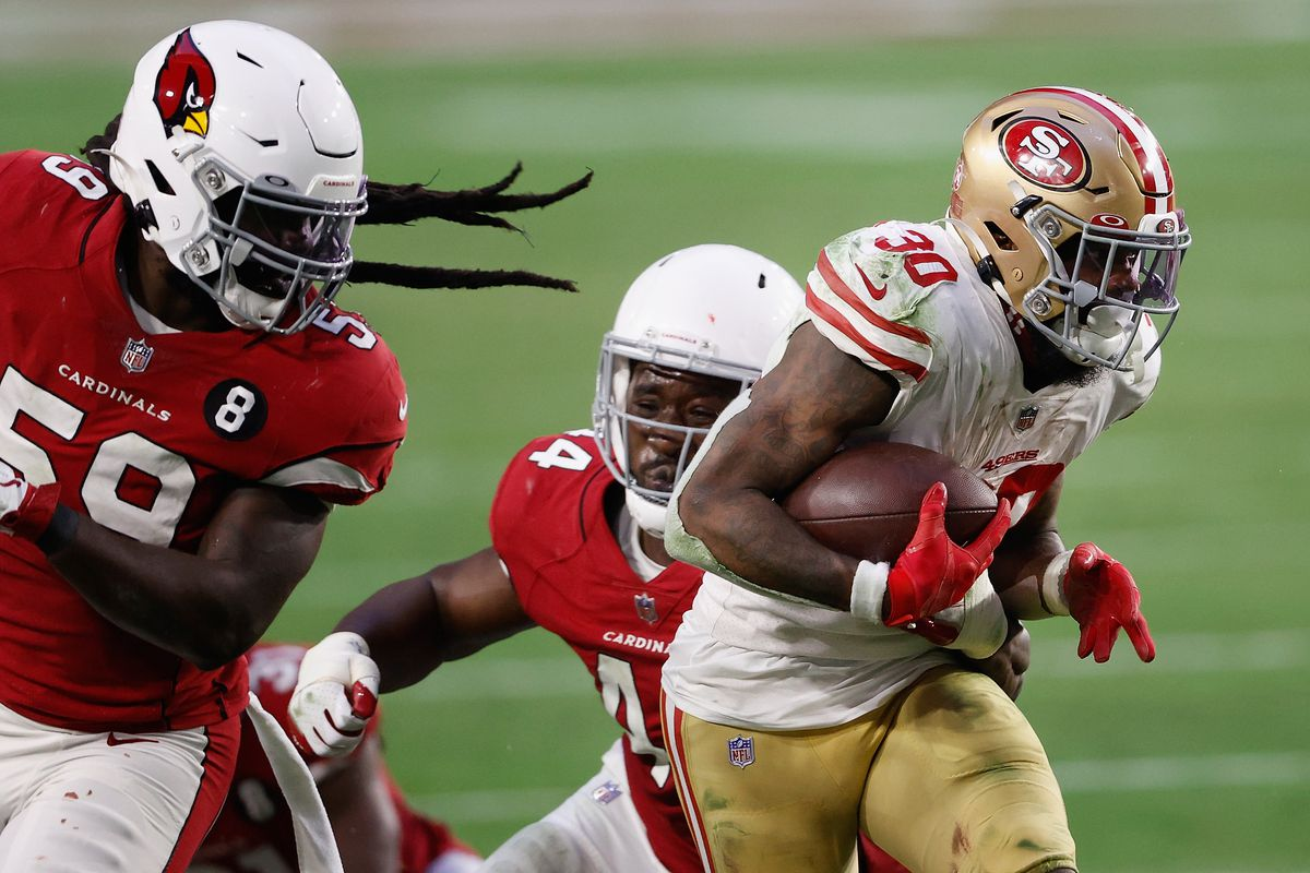 Running back Jeff Wilson #30 of the San Francisco 49ers rushes the football against the Arizona Cardinals during the fourth quarter of the NFL game at State Farm Stadium on December 26, 2020 in Glendale, Arizona.