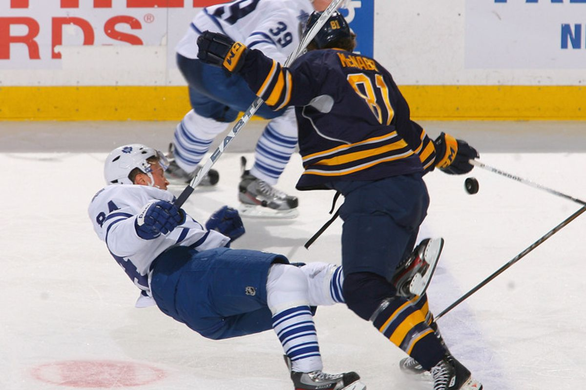 BUFFALO, NY - DECEMBER 16: Mikhail Grabovski #84 of the Toronto Maple Leafs is checked off his feet by Brayden McNabb #81 of the Buffalo Sabres at First Niagara Center on December 16, 2011 in Buffalo, New York.  (Photo by Rick Stewart/Getty Images)