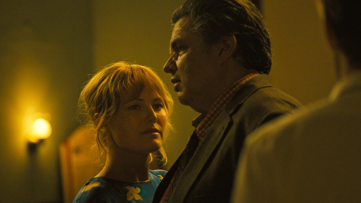 "Sam (Malin Akerman) and Bob (Oliver Platt) share a dance in ""The Ticket.""   SHOUT FACTORY FILMS"
