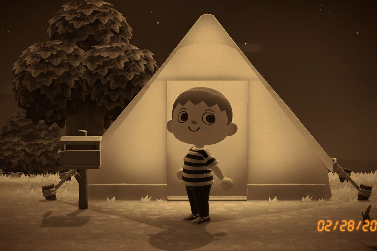 A boy stands in front of a tent in Animal Crossing New Horizons
