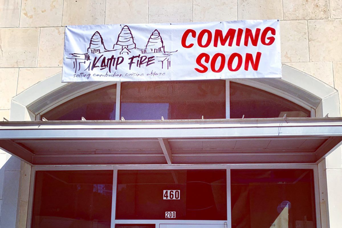 """The exterior of Kamp Fire Cambodian restaurant with a """"coming soon"""" sign"""
