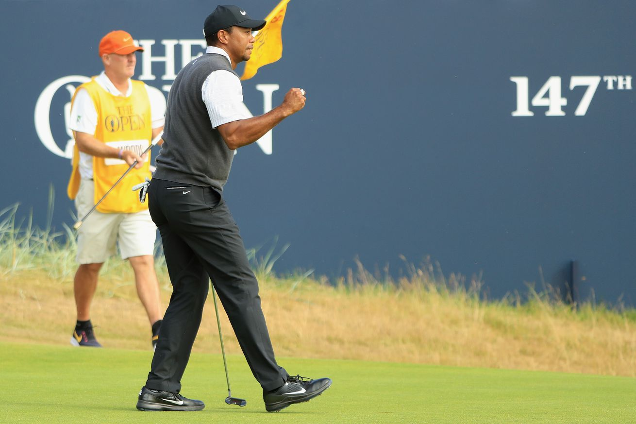 Tiger taps in for a critical finishing par save that keeps him in the hunt for Sunday.